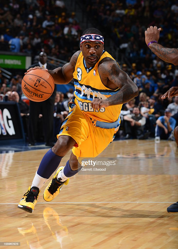<a gi-track='captionPersonalityLinkClicked' href=/galleries/search?phrase=Ty+Lawson&family=editorial&specificpeople=4024882 ng-click='$event.stopPropagation()'>Ty Lawson</a> #3 of the Denver Nuggets drives against the Utah Jazz on November 9, 2012 at the Pepsi Center in Denver, Colorado.
