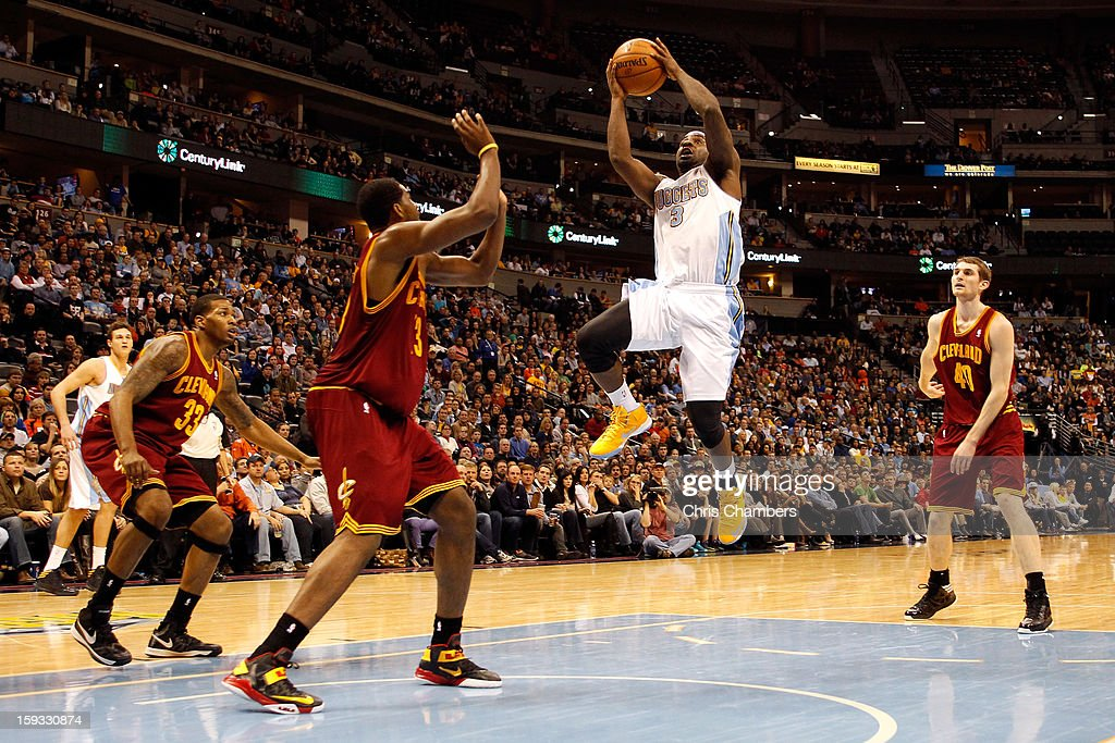 <a gi-track='captionPersonalityLinkClicked' href=/galleries/search?phrase=Ty+Lawson&family=editorial&specificpeople=4024882 ng-click='$event.stopPropagation()'>Ty Lawson</a> #3 of the Denver Nuggets drives for a shot attempt in the second half against <a gi-track='captionPersonalityLinkClicked' href=/galleries/search?phrase=Tristan+Thompson&family=editorial&specificpeople=5799092 ng-click='$event.stopPropagation()'>Tristan Thompson</a> #13 of the Cleveland Cavaliers at Pepsi Center on January 11, 2013 in Denver, Colorado.