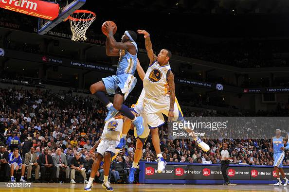Ty Lawson of the Denver Nuggets drives the ball against Monta Ellis of the Golden State Warriors on November 22 2010 at Oracle Arena in Oakland...