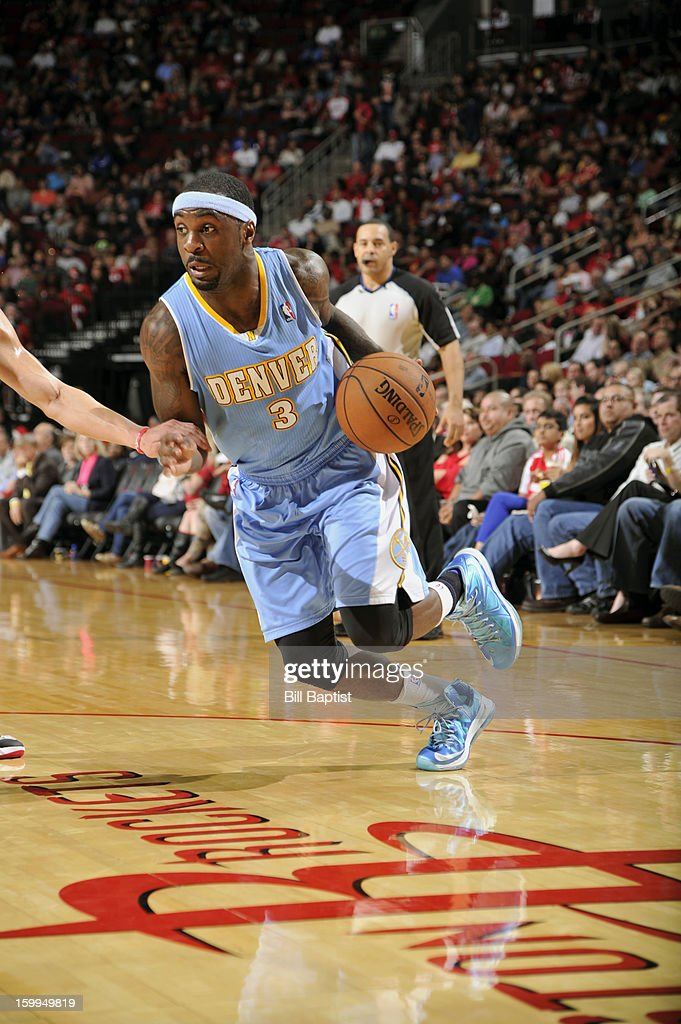 Ty Lawson #3 of the Denver Nuggets drives the ball against the Houston Rockets on January 23, 2013 at the Toyota Center in Houston, Texas.