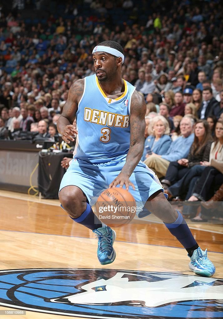 Ty Lawson #3 of the Denver Nuggets drives the ball during the game between the Minnesota Timberwolves and the Denver Nuggets on November 21, 2012 at Target Center in Minneapolis, Minnesota.