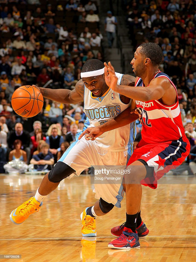 Ty Lawson #3 of the Denver Nuggets drives to the basket against A.J. Price #12 of the Washington Wizards at the Pepsi Center on January 18, 2013 in Denver, Colorado. The Wizards defeated the Nuggets 112-108.