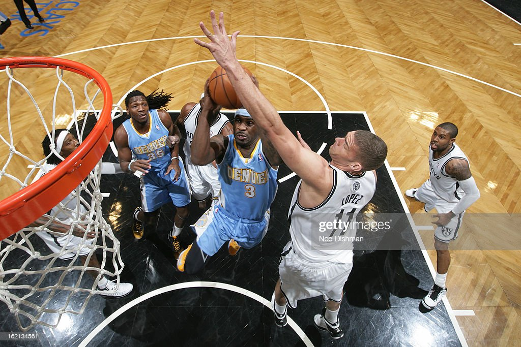 <a gi-track='captionPersonalityLinkClicked' href=/galleries/search?phrase=Ty+Lawson&family=editorial&specificpeople=4024882 ng-click='$event.stopPropagation()'>Ty Lawson</a> #3 of the Denver Nuggets drives to the basket against <a gi-track='captionPersonalityLinkClicked' href=/galleries/search?phrase=Brook+Lopez&family=editorial&specificpeople=3847328 ng-click='$event.stopPropagation()'>Brook Lopez</a> #11 of the Brooklyn Nets on February 13, 2013 at the Barclays Center in the Brooklyn borough of New York City in New York City.