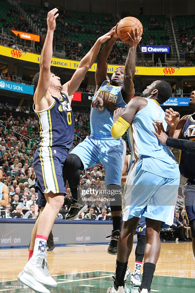 <a gi-track='captionPersonalityLinkClicked' href=/galleries/search?phrase=Ty+Lawson&family=editorial&specificpeople=4024882 ng-click='$event.stopPropagation()'>Ty Lawson</a> #3 of the Denver Nuggets drives to the basket against <a gi-track='captionPersonalityLinkClicked' href=/galleries/search?phrase=Enes+Kanter&family=editorial&specificpeople=5621416 ng-click='$event.stopPropagation()'>Enes Kanter</a> #0 of the Utah Jazz at EnergySolutions Arena on November 11, 2013 in Salt Lake City, Utah.