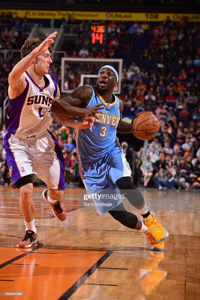 <a gi-track='captionPersonalityLinkClicked' href=/galleries/search?phrase=Ty+Lawson&family=editorial&specificpeople=4024882 ng-click='$event.stopPropagation()'>Ty Lawson</a> #3 of the Denver Nuggets drives to the basket against <a gi-track='captionPersonalityLinkClicked' href=/galleries/search?phrase=Goran+Dragic&family=editorial&specificpeople=4452965 ng-click='$event.stopPropagation()'>Goran Dragic</a> #1 of the Phoenix Suns on March 11, 2013 at U.S. Airways Center in Phoenix, Arizona.