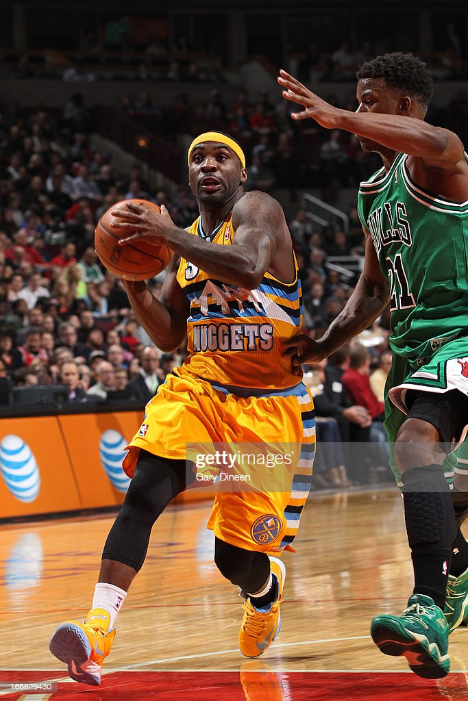 <a gi-track='captionPersonalityLinkClicked' href=/galleries/search?phrase=Ty+Lawson&family=editorial&specificpeople=4024882 ng-click='$event.stopPropagation()'>Ty Lawson</a> #3 of the Denver Nuggets drives to the basket against <a gi-track='captionPersonalityLinkClicked' href=/galleries/search?phrase=Jimmy+Butler+-+Basketball+Player&family=editorial&specificpeople=9860567 ng-click='$event.stopPropagation()'>Jimmy Butler</a> #21 of the Chicago Bulls on March 18, 2013 at the United Center in Chicago, Illinois.
