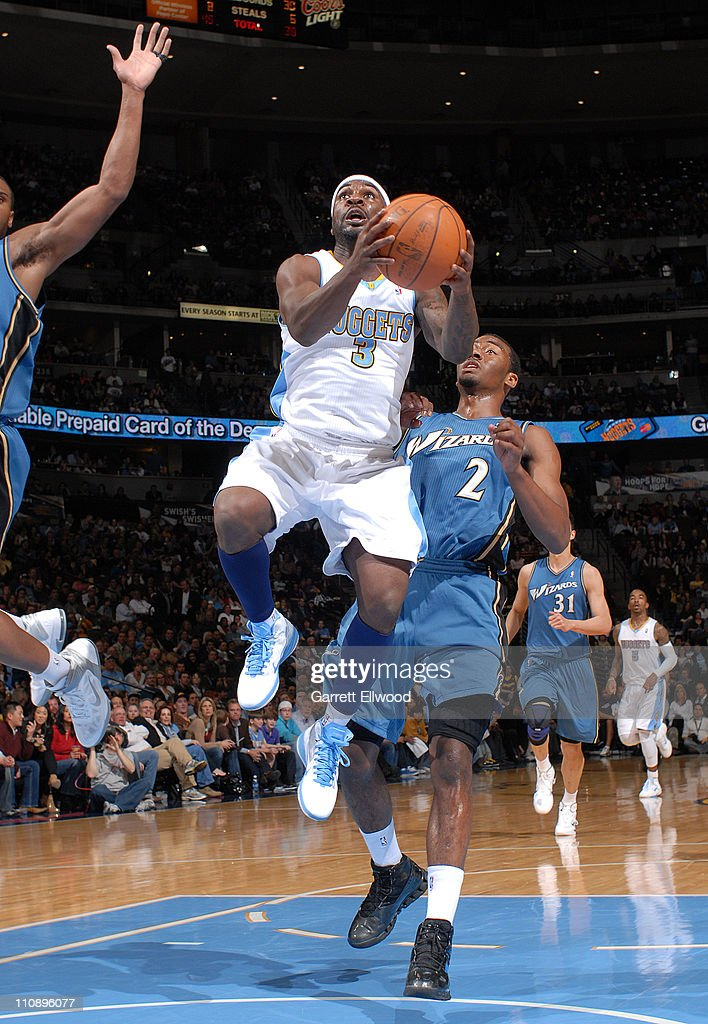 <a gi-track='captionPersonalityLinkClicked' href=/galleries/search?phrase=Ty+Lawson&family=editorial&specificpeople=4024882 ng-click='$event.stopPropagation()'>Ty Lawson</a> #3 of the Denver Nuggets drives to the basket against <a gi-track='captionPersonalityLinkClicked' href=/galleries/search?phrase=John+Wall&family=editorial&specificpeople=2265812 ng-click='$event.stopPropagation()'>John Wall</a> #2 of the Washington Wizards on March 25, 2011 at the Pepsi Center in Denver, Colorado.