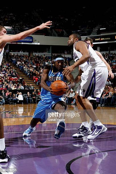 Ty Lawson of the Denver Nuggets drives to the basket against Kenny Thomas of the Sacramento Kings on December 28 2009 at ARCO Arena in Sacramento...