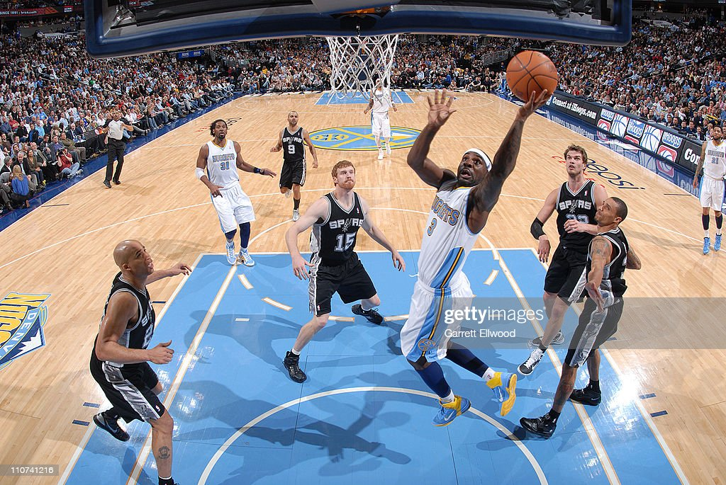 <a gi-track='captionPersonalityLinkClicked' href=/galleries/search?phrase=Ty+Lawson&family=editorial&specificpeople=4024882 ng-click='$event.stopPropagation()'>Ty Lawson</a> #3 of the Denver Nuggets drives to the basket against <a gi-track='captionPersonalityLinkClicked' href=/galleries/search?phrase=Matt+Bonner&family=editorial&specificpeople=203054 ng-click='$event.stopPropagation()'>Matt Bonner</a> #15 of the San Antonio Spurs on March 23, 2011 at the Pepsi Center in Denver, Colorado.