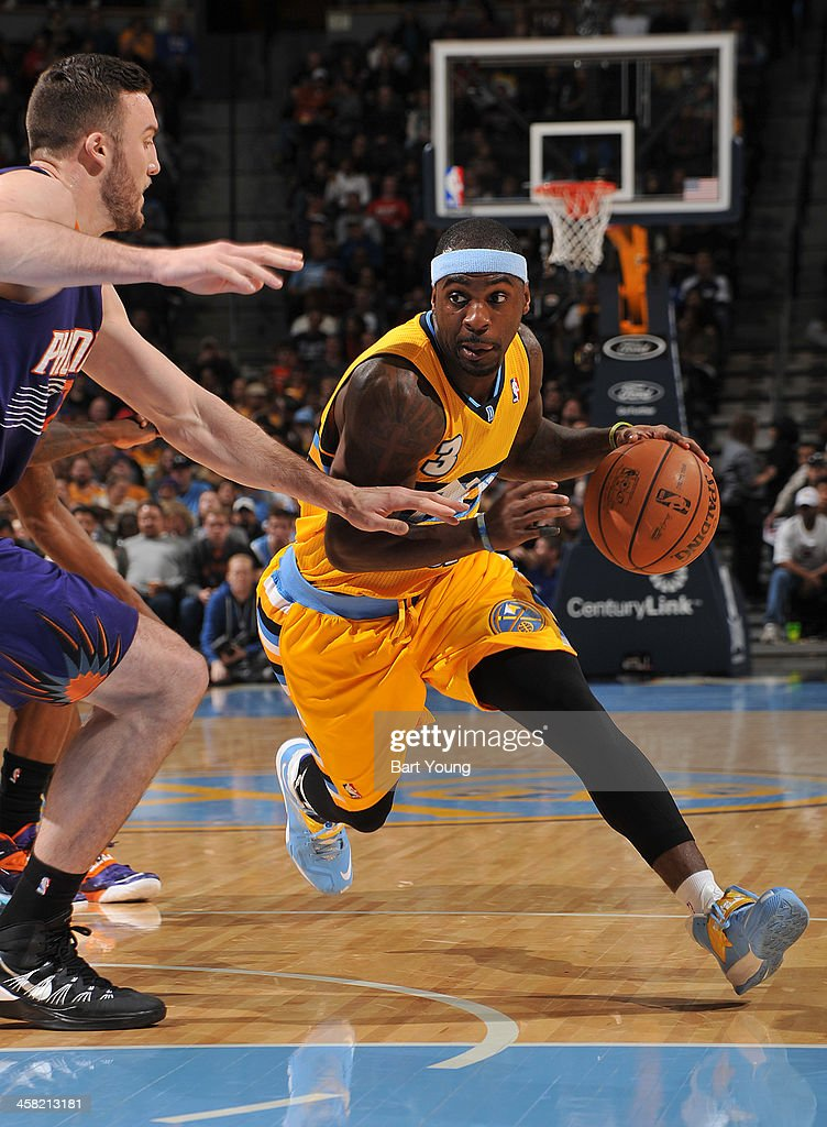 <a gi-track='captionPersonalityLinkClicked' href=/galleries/search?phrase=Ty+Lawson&family=editorial&specificpeople=4024882 ng-click='$event.stopPropagation()'>Ty Lawson</a> #3 of the Denver Nuggets drives to the basket against Phoenix Suns on December 20, 2013 at the Pepsi Center in Denver, Colorado.