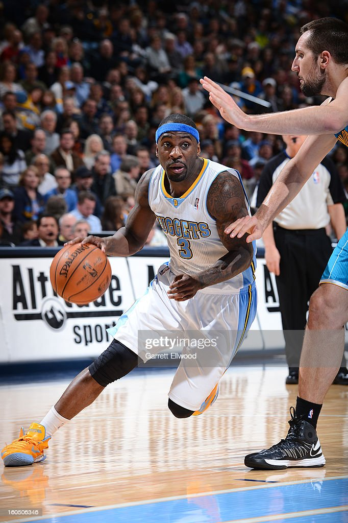 Ty Lawson #3 of the Denver Nuggets drives to the basket against the New Orleans Hornets on February 1, 2013 at the Pepsi Center in Denver, Colorado.