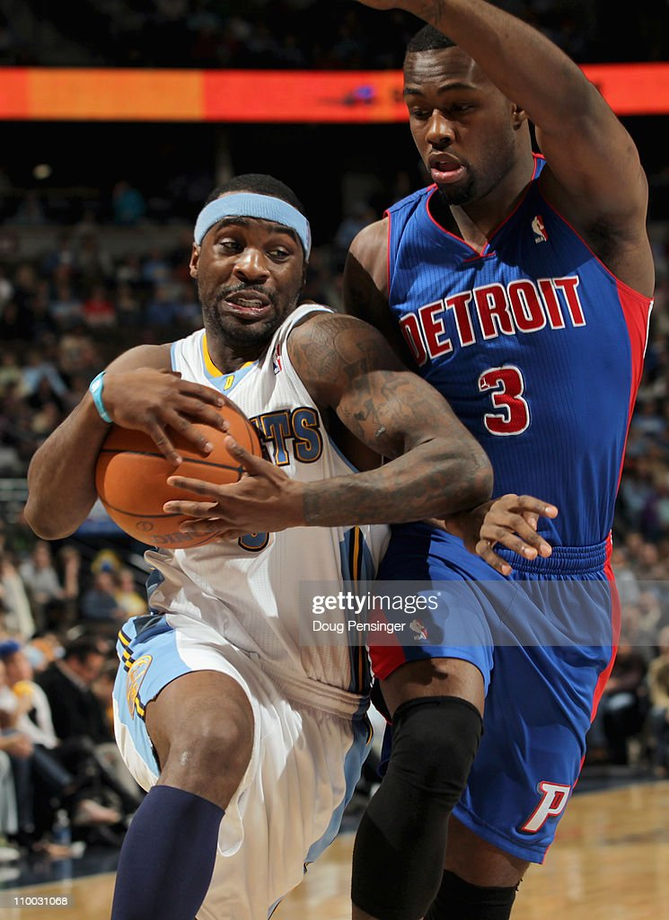 Ty Lawson #3 of the Denver Nuggets drives to the basket against the defense of Rodney Stuckey #3 of the Detroit Pistons at the Pepsi Center on March 12, 2011 in Denver, Colorado. The Nuggets defeated the Pistons 131-101.
