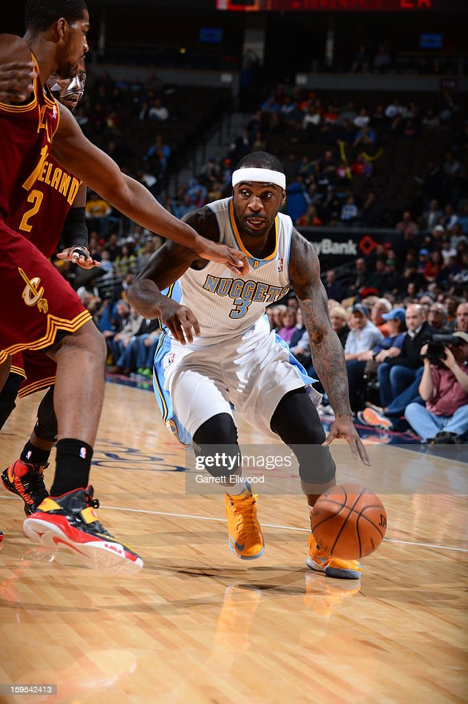 <a gi-track='captionPersonalityLinkClicked' href=/galleries/search?phrase=Ty+Lawson&family=editorial&specificpeople=4024882 ng-click='$event.stopPropagation()'>Ty Lawson</a> #3 of the Denver Nuggets drives to the basket against the Cleveland Cavaliers on January 11, 2013 at the Pepsi Center in Denver, Colorado.