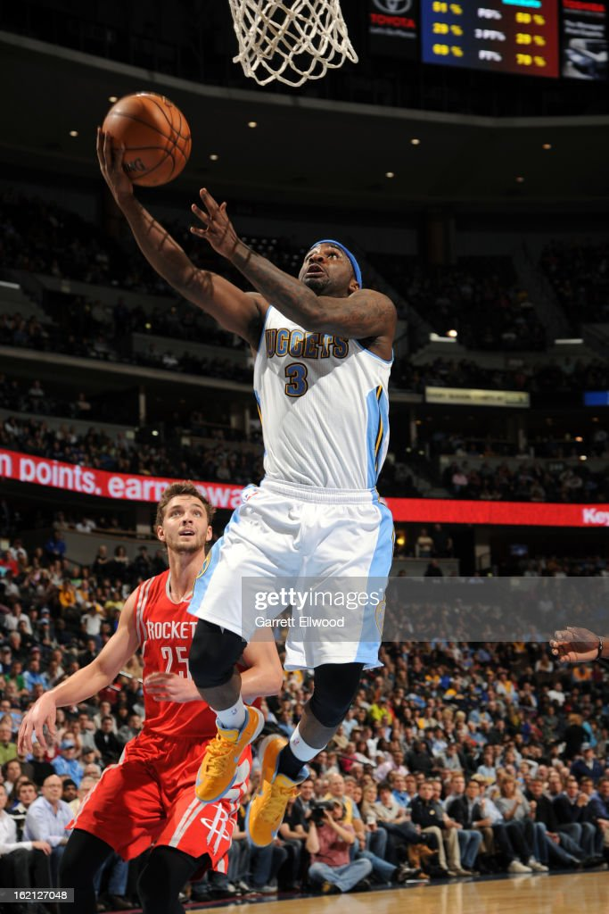 Ty Lawson #3 of the Denver Nuggets drives to the basket against the Houston Rockets on January 30, 2013 at the Pepsi Center in Denver, Colorado.