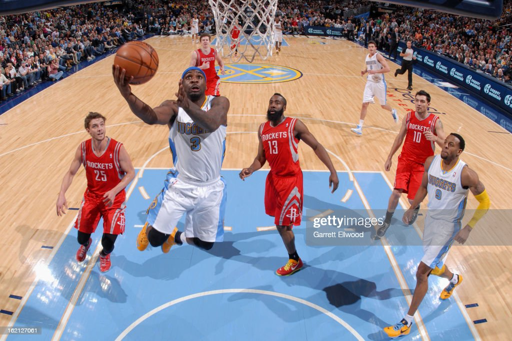 <a gi-track='captionPersonalityLinkClicked' href=/galleries/search?phrase=Ty+Lawson&family=editorial&specificpeople=4024882 ng-click='$event.stopPropagation()'>Ty Lawson</a> #3 of the Denver Nuggets drives to the basket against the Houston Rockets on January 30, 2013 at the Pepsi Center in Denver, Colorado.