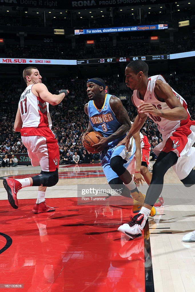 <a gi-track='captionPersonalityLinkClicked' href=/galleries/search?phrase=Ty+Lawson&family=editorial&specificpeople=4024882 ng-click='$event.stopPropagation()'>Ty Lawson</a> #3 of the Denver Nuggets drives to the basket against the Toronto Raptors on February 12, 2013 at the Air Canada Centre in Toronto, Ontario, Canada.