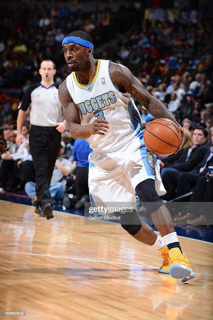 <a gi-track='captionPersonalityLinkClicked' href=/galleries/search?phrase=Ty+Lawson&family=editorial&specificpeople=4024882 ng-click='$event.stopPropagation()'>Ty Lawson</a> #3 of the Denver Nuggets drives to the basket against the Indiana Pacers on January 28, 2013 at the Pepsi Center in Denver, Colorado.