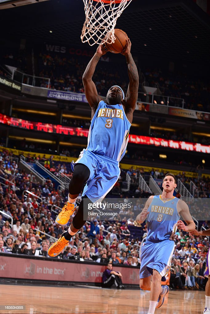 <a gi-track='captionPersonalityLinkClicked' href=/galleries/search?phrase=Ty+Lawson&family=editorial&specificpeople=4024882 ng-click='$event.stopPropagation()'>Ty Lawson</a> #3 of the Denver Nuggets drives to the basket against the Phoenix Suns on March 11, 2013 at U.S. Airways Center in Phoenix, Arizona.