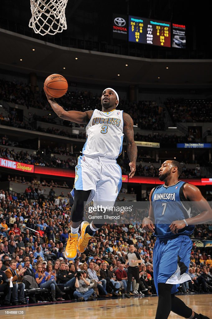 <a gi-track='captionPersonalityLinkClicked' href=/galleries/search?phrase=Ty+Lawson&family=editorial&specificpeople=4024882 ng-click='$event.stopPropagation()'>Ty Lawson</a> #3 of the Denver Nuggets drives to the basket against the Minnesota Timberwolves on March 9, 2013 at the Pepsi Center in Denver, Colorado.