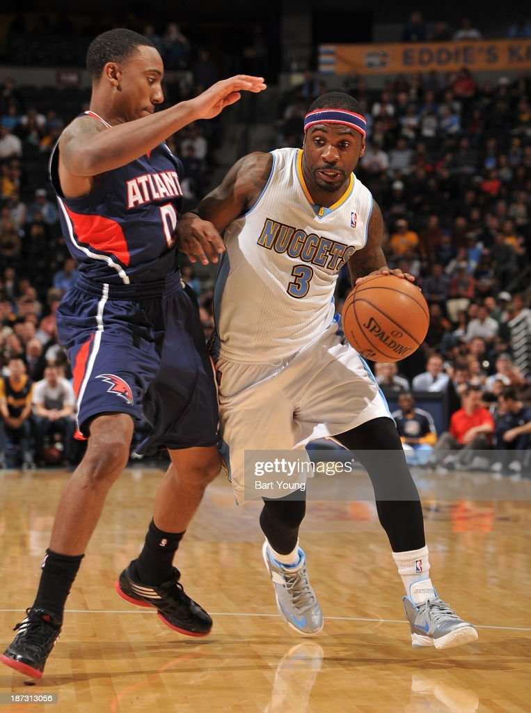 <a gi-track='captionPersonalityLinkClicked' href=/galleries/search?phrase=Ty+Lawson&family=editorial&specificpeople=4024882 ng-click='$event.stopPropagation()'>Ty Lawson</a> #3 of the Denver Nuggets drives to the basket against the Atlanta Hawks on November 7, 2013 at the Pepsi Center in Denver, Colorado.