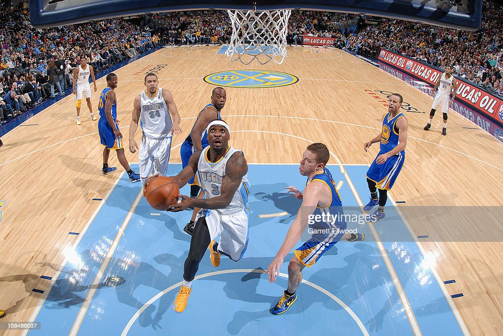 <a gi-track='captionPersonalityLinkClicked' href=/galleries/search?phrase=Ty+Lawson&family=editorial&specificpeople=4024882 ng-click='$event.stopPropagation()'>Ty Lawson</a> #3 of the Denver Nuggets drives to the basket against the Golden State Warriors on January 13, 2013 at the Pepsi Center in Denver, Colorado.