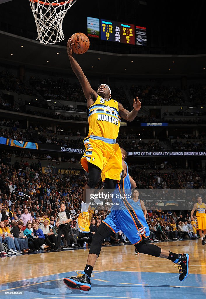 Ty Lawson #3 of the Denver Nuggets drives to the basket against the Oklahoma City Thunder on January 20, 2013 at the Pepsi Center in Denver, Colorado.