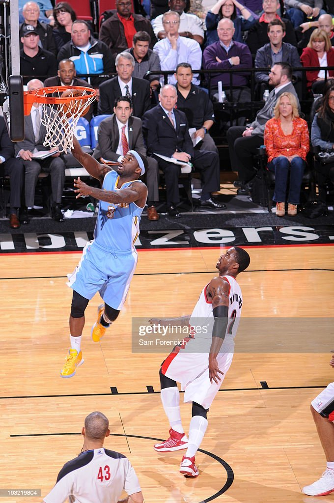 <a gi-track='captionPersonalityLinkClicked' href=/galleries/search?phrase=Ty+Lawson&family=editorial&specificpeople=4024882 ng-click='$event.stopPropagation()'>Ty Lawson</a> #3 of the Denver Nuggets drives to the basket against the Portland Trail Blazers on February 27, 2013 at the Rose Garden Arena in Portland, Oregon.