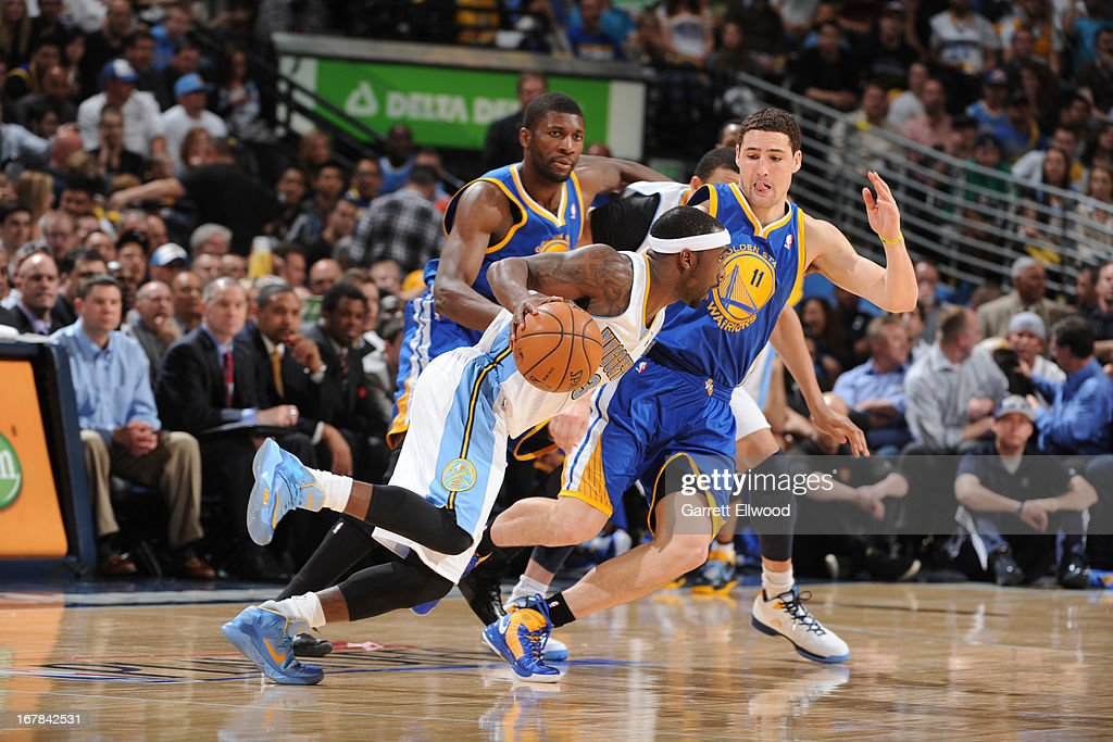 <a gi-track='captionPersonalityLinkClicked' href=/galleries/search?phrase=Ty+Lawson&family=editorial&specificpeople=4024882 ng-click='$event.stopPropagation()'>Ty Lawson</a> #3 of the Denver Nuggets drives to the basket against the Golden State Warriors in Game Five of the Western Conference Quarterfinals during the 2013 NBA Playoffs on April 30, 2013 at the Pepsi Center in Denver, Colorado.