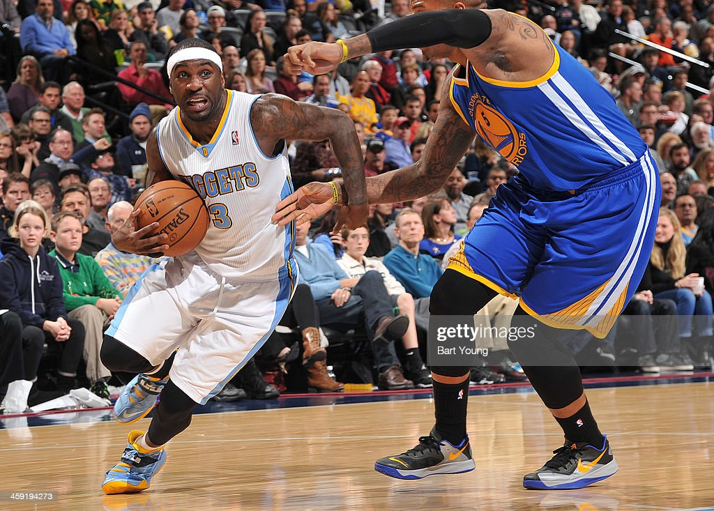 <a gi-track='captionPersonalityLinkClicked' href=/galleries/search?phrase=Ty+Lawson&family=editorial&specificpeople=4024882 ng-click='$event.stopPropagation()'>Ty Lawson</a> #3 of the Denver Nuggets drives to the basket against the Golden State Warriors on December 23, 2013 at the Pepsi Center in Denver, Colorado.
