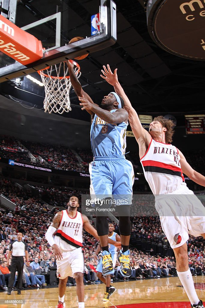 <a gi-track='captionPersonalityLinkClicked' href=/galleries/search?phrase=Ty+Lawson&family=editorial&specificpeople=4024882 ng-click='$event.stopPropagation()'>Ty Lawson</a> #3 of the Denver Nuggets drives to the basket against the Portland Trail Blazers on January 23, 2014 at the Moda Center Arena in Portland, Oregon.