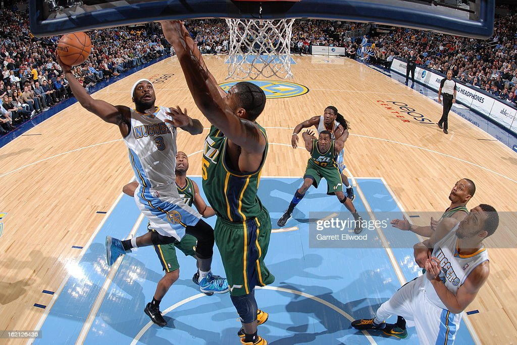 <a gi-track='captionPersonalityLinkClicked' href=/galleries/search?phrase=Ty+Lawson&family=editorial&specificpeople=4024882 ng-click='$event.stopPropagation()'>Ty Lawson</a> #3 of the Denver Nuggets drives to the basket against the Utah Jazz on January 5, 2013 at the Pepsi Center in Denver, Colorado.