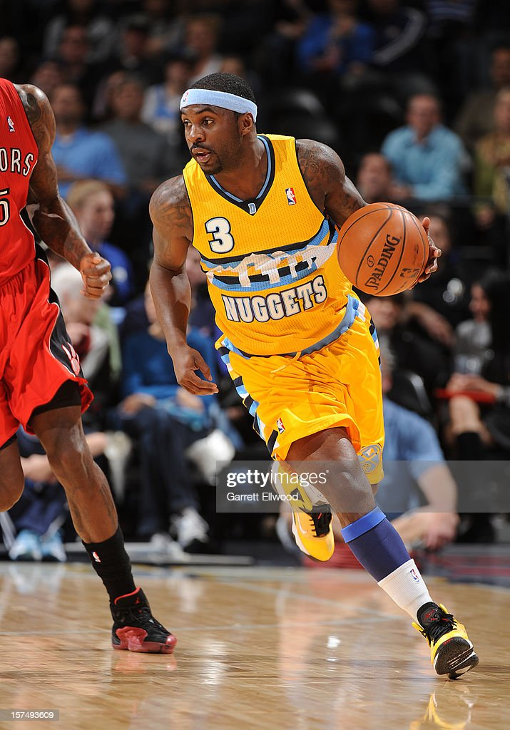Ty Lawson #3 of the Denver Nuggets drives up the court against the Toronto Raptors on December 3, 2012 at the Pepsi Center in Denver, Colorado.