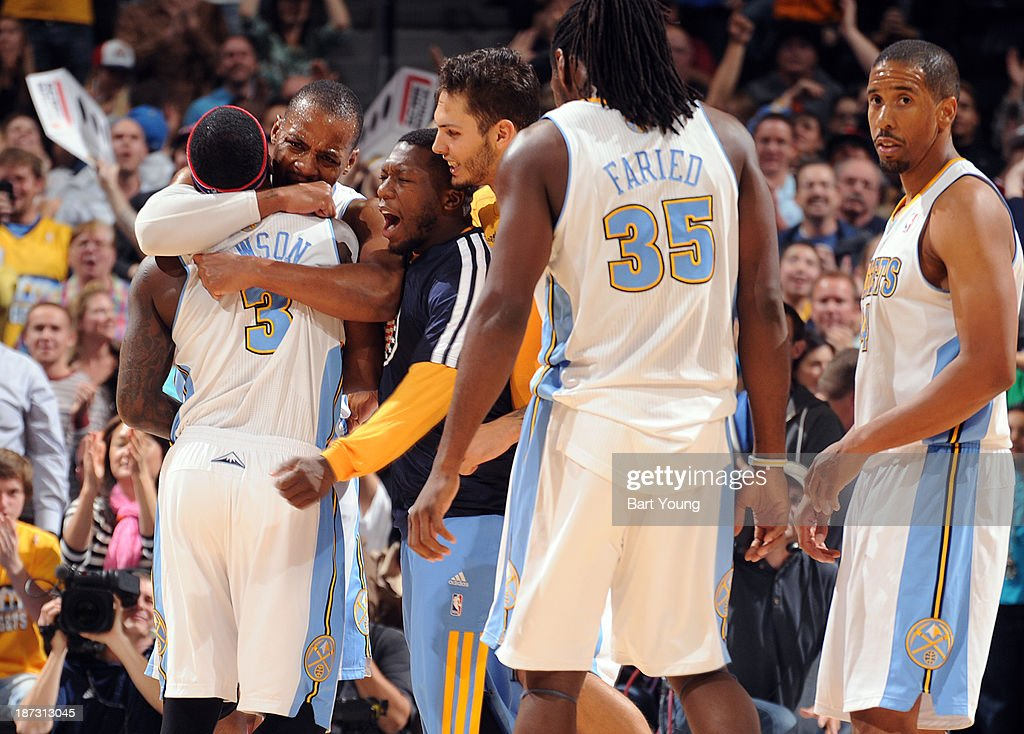 <a gi-track='captionPersonalityLinkClicked' href=/galleries/search?phrase=Ty+Lawson&family=editorial&specificpeople=4024882 ng-click='$event.stopPropagation()'>Ty Lawson</a> #3 of the Denver Nuggets gets a hug from his teammates against the Atlanta Hawks on November 7, 2013 at the Pepsi Center in Denver, Colorado.