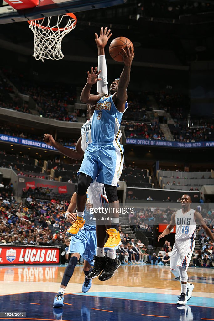 Ty Lawson #3 of the Denver Nuggets goes to the basket against Bismack Biyombo #0 of the Charlotte Bobcats at the Time Warner Cable Arena on February 23, 2013 in Charlotte, North Carolina.