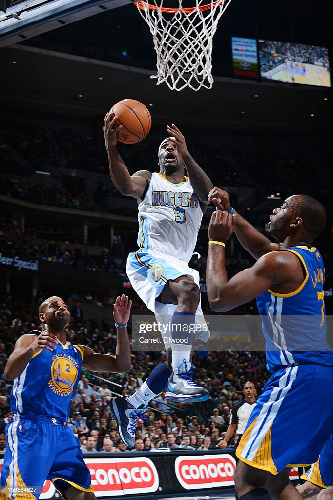Ty Lawson #3 of the Denver Nuggets goes to the basket against Carl Landry #7 of the Golden State Warriors on November 23, 2012 at the Pepsi Center in Denver, Colorado.