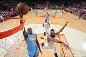 Ty Lawson of the Denver Nuggets goes to the basket against James Harden of the Houston Rockets on December 13 2014 at the Toyota Center in Houston...