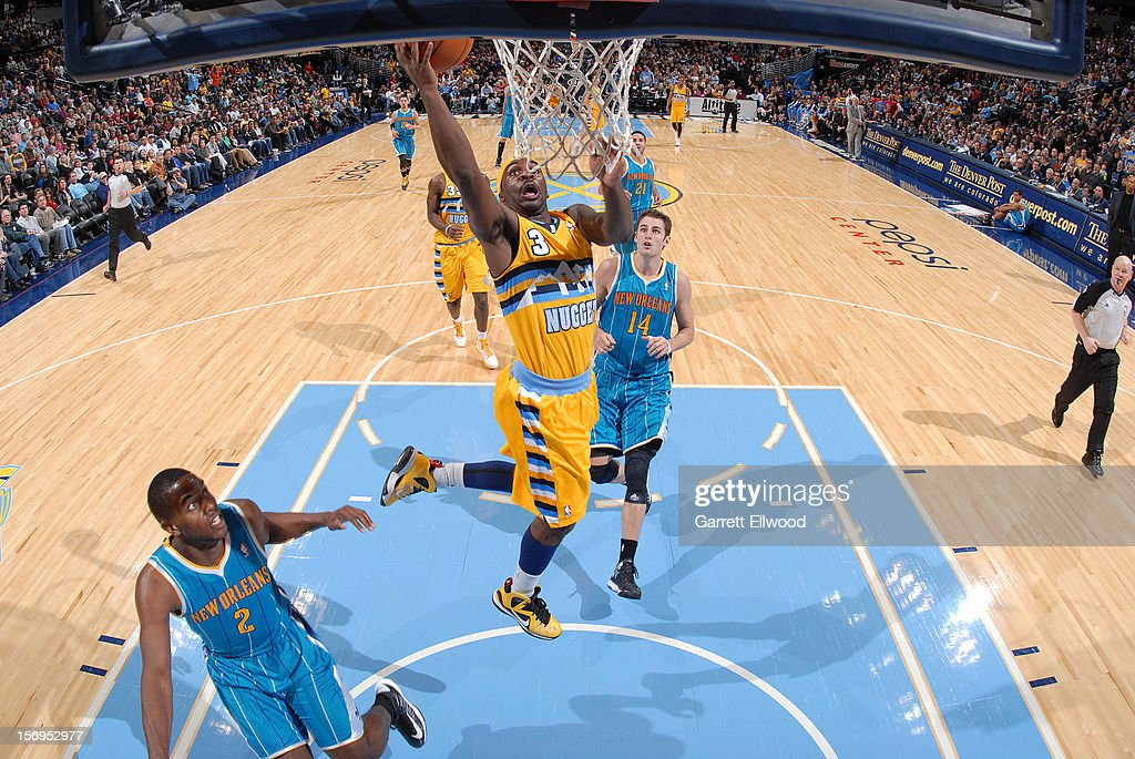 <a gi-track='captionPersonalityLinkClicked' href=/galleries/search?phrase=Ty+Lawson&family=editorial&specificpeople=4024882 ng-click='$event.stopPropagation()'>Ty Lawson</a> #3 of the Denver Nuggets goes to the basket against Jason Smith #14 of the New Orleans Hornets during the game between the New Orleans Hornets and the Denver Nuggets on November 25, 2012 at the Pepsi Center in Denver, Colorado.