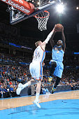 Ty Lawson of the Denver Nuggets goes to the basket against Kyle Singler of the Oklahoma City Thunder on February 22 2015 at the Chesapeake Energy...