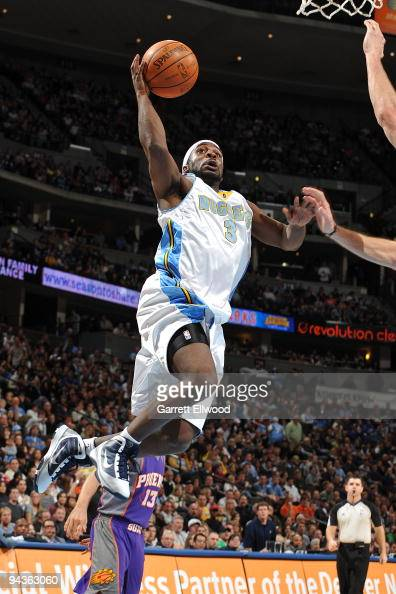 Ty Lawson of the Denver Nuggets goes to the basket against the Phoenix Suns on December 12 2009 at the Pepsi Center in Denver Colorado NOTE TO USER...
