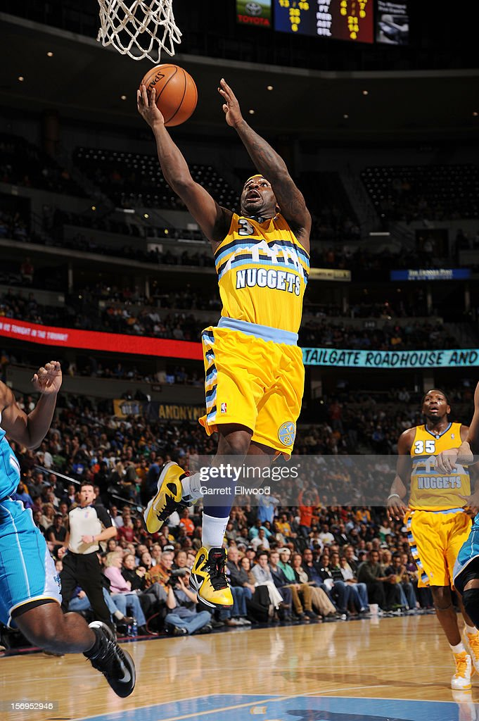 Ty Lawson #3 of the Denver Nuggets goes to the basket during the game between the New Orleans Hornets and the Denver Nuggets on November 25, 2012 at the Pepsi Center in Denver, Colorado.