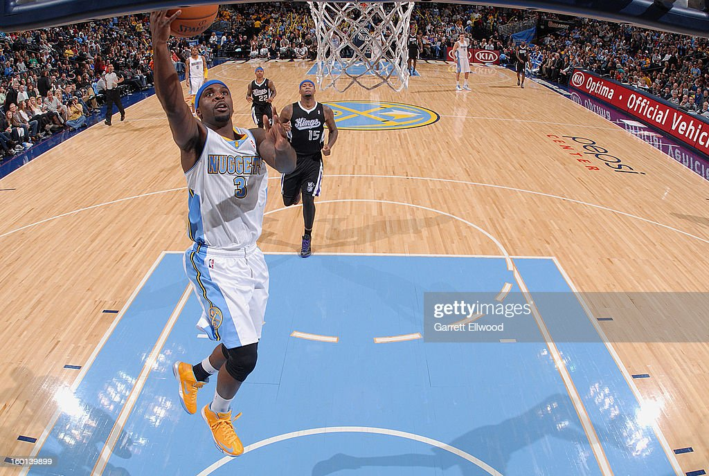 <a gi-track='captionPersonalityLinkClicked' href=/galleries/search?phrase=Ty+Lawson&family=editorial&specificpeople=4024882 ng-click='$event.stopPropagation()'>Ty Lawson</a> #3 of the Denver Nuggets goes to the basket during the game between the Sacramento Kings and the Denver Nuggets on January 26, 2013 at the Pepsi Center in Denver, Colorado.