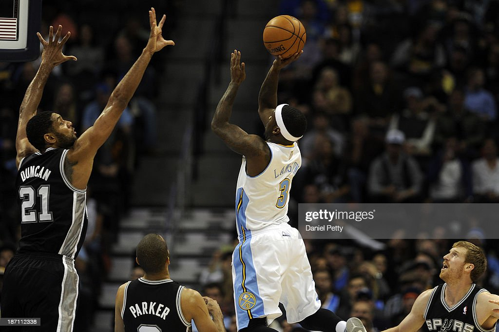 Ty Lawson #3 of the Denver Nuggets goes up for a floating jump shot against Tim Duncan #21 of the San Antonio Spurs during the fourth quarter of an NBA game at the Pepsi Center on November 5, 2013, in Denver, Colorado. The Nuggets fell to the Spurs 102-94 and are now 0-3.