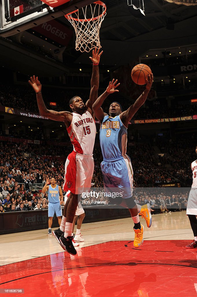 <a gi-track='captionPersonalityLinkClicked' href=/galleries/search?phrase=Ty+Lawson&family=editorial&specificpeople=4024882 ng-click='$event.stopPropagation()'>Ty Lawson</a> #3 of the Denver Nuggets goes up for the shot against <a gi-track='captionPersonalityLinkClicked' href=/galleries/search?phrase=Amir+Johnson&family=editorial&specificpeople=556786 ng-click='$event.stopPropagation()'>Amir Johnson</a> #15 of the Toronto Raptors during the game on February 12, 2013 at the Air Canada Centre in Toronto, Ontario, Canada.
