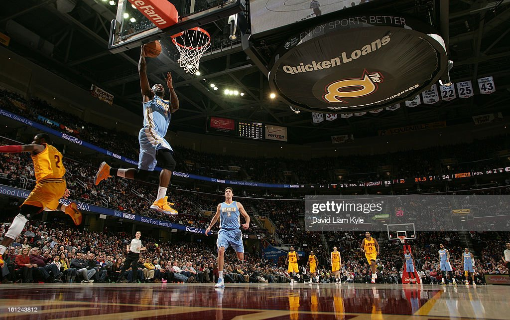 Ty Lawson #3 of the Denver Nuggets goes up for the shot against Kyrie Irving #2 of the Cleveland Cavaliers at The Quicken Loans Arena on February 9, 2013 in Cleveland, Ohio.