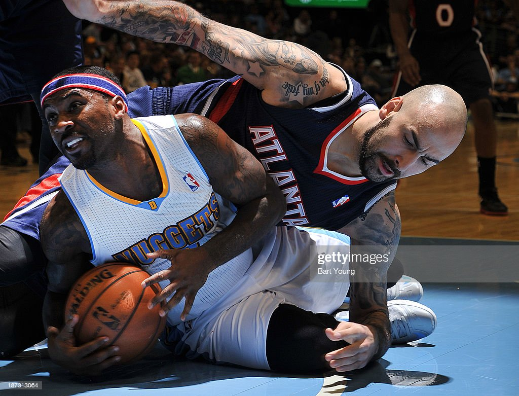 <a gi-track='captionPersonalityLinkClicked' href=/galleries/search?phrase=Ty+Lawson&family=editorial&specificpeople=4024882 ng-click='$event.stopPropagation()'>Ty Lawson</a> #3 of the Denver Nuggets grabs the ball against the Atlanta Hawks on November 7, 2013 at the Pepsi Center in Denver, Colorado.