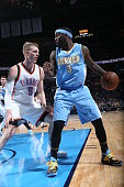 Ty Lawson of the Denver Nuggets handles the ball against Kyle Singler of the Oklahoma City Thunder on February 22 2015 at the Chesapeake Energy Arena...