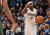 Ty Lawson of the Denver Nuggets handles the ball against the Milwaukee Bucks on February 5 2014 at the Pepsi Center in Denver Colorado NOTE TO USER...
