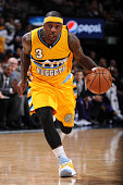 Ty Lawson of the Denver Nuggets handles the ball against the Sacramento Kings on April 12 2015 at the Pepsi Center in Denver Colorado NOTE TO USER...