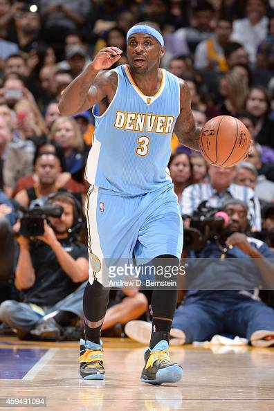 Ty Lawson of the Denver Nuggets handles the ball against the Los Angeles Lakers at STAPLES Center on November 23 2014 in Los Angeles California NOTE...