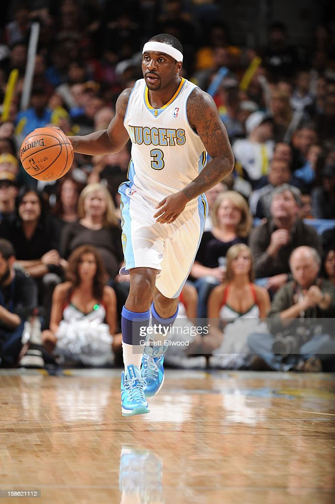 <a gi-track='captionPersonalityLinkClicked' href=/galleries/search?phrase=Ty+Lawson&family=editorial&specificpeople=4024882 ng-click='$event.stopPropagation()'>Ty Lawson</a> #3 of the Denver Nuggets handles the ball against the Memphis Grizzlies on December 14, 2012 at the Pepsi Center in Denver, Colorado.